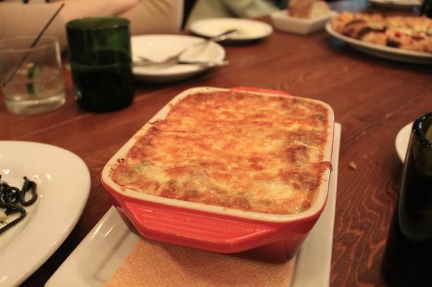 Lasagna bolognese with pasta verde, bechamel, mozzarella, pork ragu
