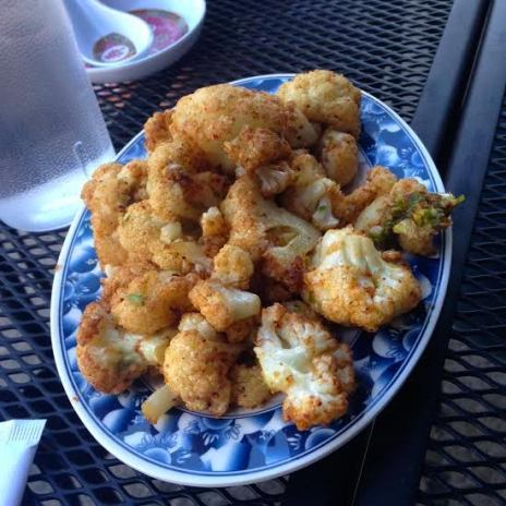 Fried cauliflower with shrimp salt, lemon, and scallion