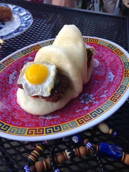 Pac Man Bun: scrapple, quail egg, and pickles