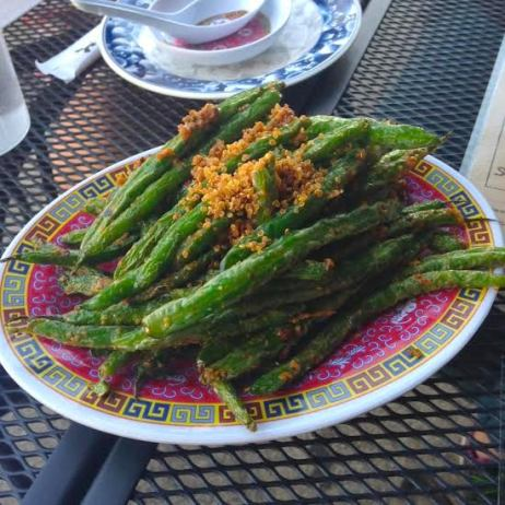 Green beans with fermented garlic and crunchy fried quinoa
